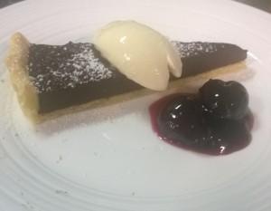 Chocolate gnache tart, sweetened mascarpone and cherry compote